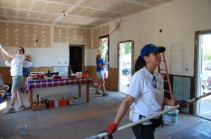 Volunteers paint at B Walker Ranch facility